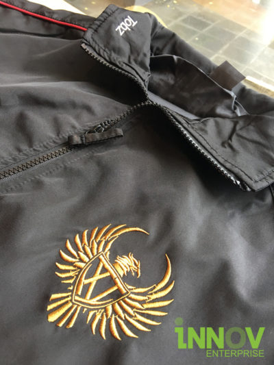 Windbreaker with golden Embroidery at the front left chest